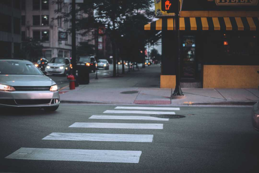 Figure 1: Car about to stop at pedestrian crossing.Photo by Wesley Armstrong on Unsplash