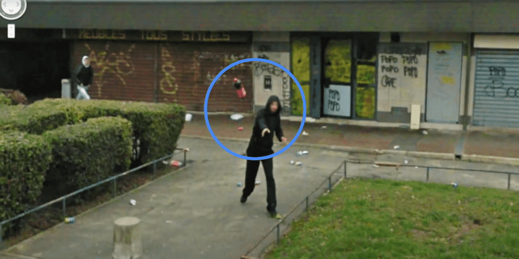 Figure 2: A citizen throws a coke bottle towards a mobile mapping vehicle as an act of protest against being captured on video/photo.